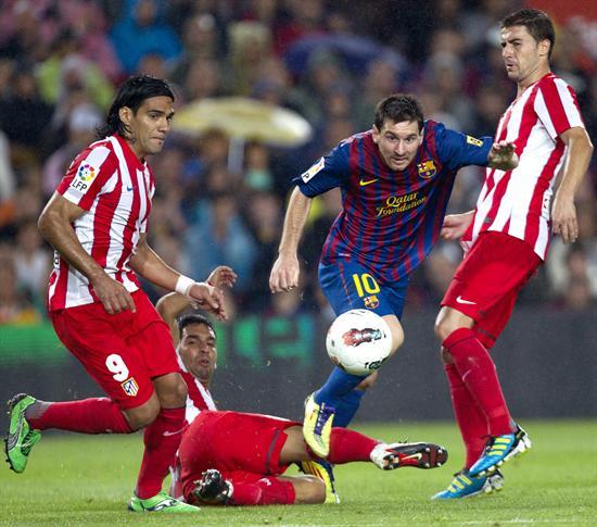 Leo Messi y Radamel Falcao García. Foto: EFE