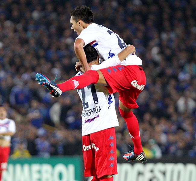 Los jugadores del argentino Tigre celebran su triunfo sobre el colombiano Millonarios. EFE