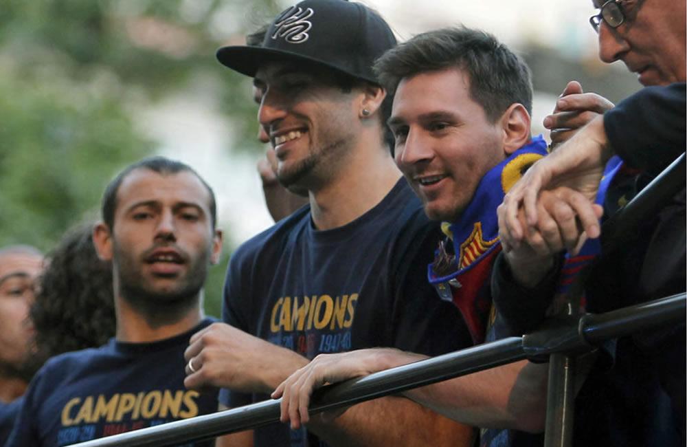 El jugador argentino del FC Barcelona, Leo Messi, junto a su compañero Juan Manuel Pinto. Foto: EFE