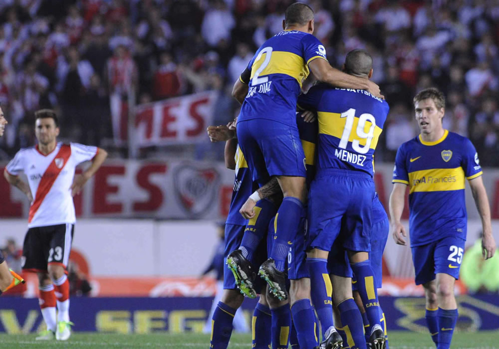 Los jugadores del Boca Juniors celebra su victoria ante River Plate. Foto: EFE