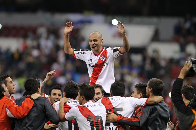 Jugadores de River Plate celebran después de vencer a Boca Juniors. Foto: EFE
