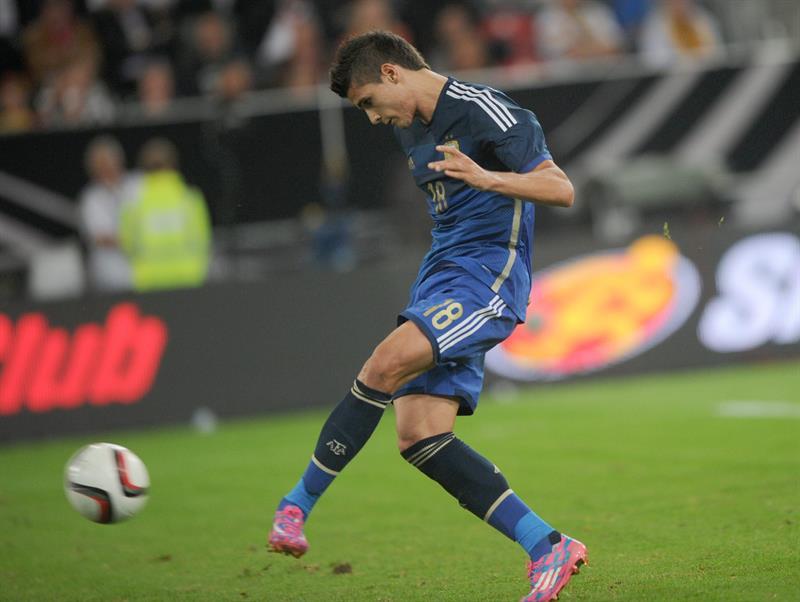 Erik Lamela de Argentina anota el 2-0 ante Alemania. EFE