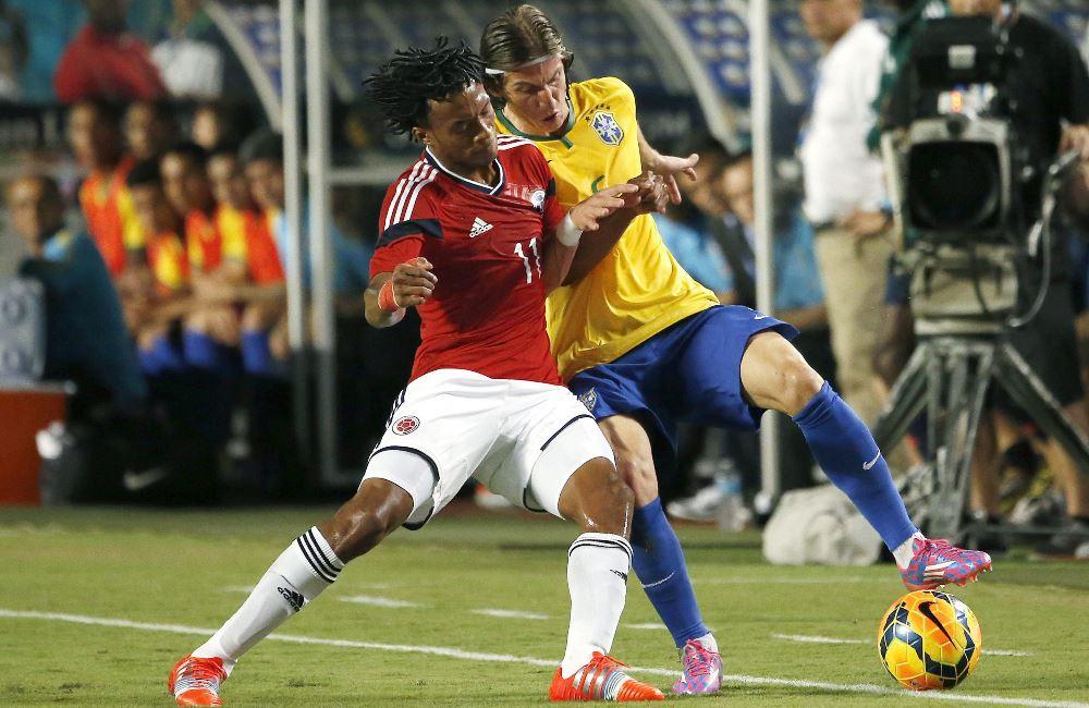 Juan Guillermo Cuadrado vio la roja en el minuto 49, cuando el juego iba 0-0. Foto: EFE.