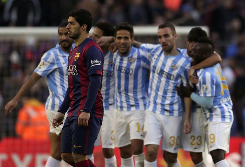 Los jugadores del Málaga celebran su victoria. Foto: EFE