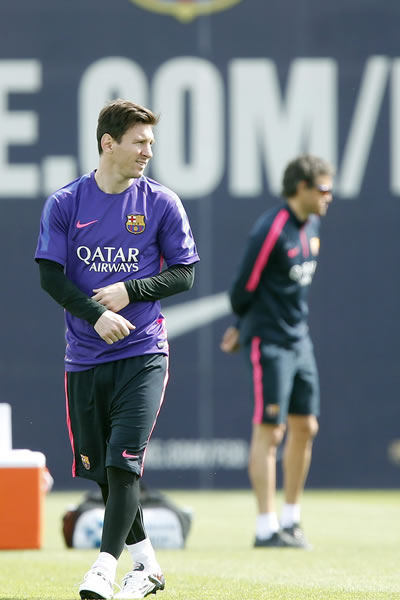 El jugador del FC Barcelona Leo Messi (i), y el técnico del club, Luis Enrique Martínez. Foto: EFE