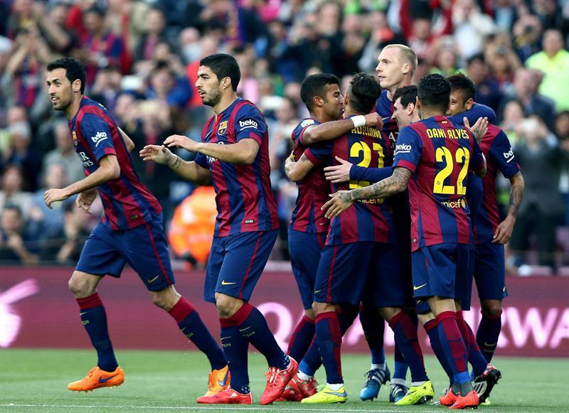 Los jugadores del Barcelona celebran su primer gol ante el Getafe, obra del delantero argentino Lionel Messi. Foto: EFE