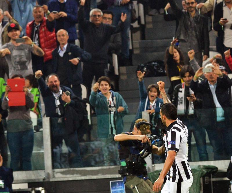 El jugador de Juventus Carlos Tevez celebra después de anotar un gol ante el Real Madrid. EFE