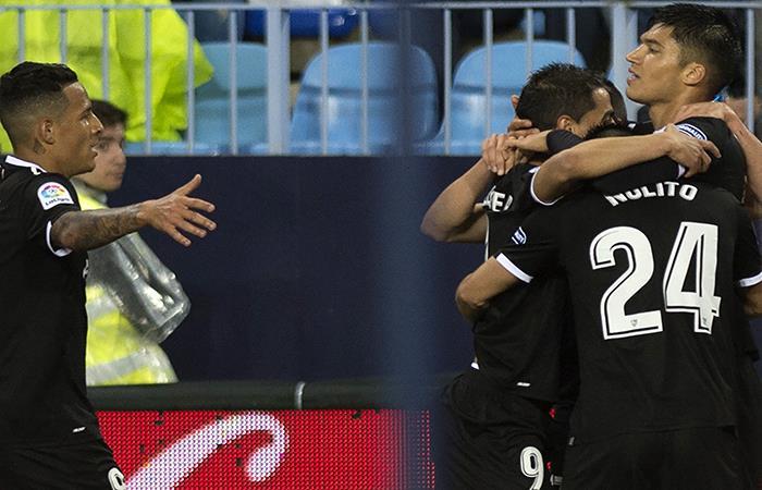 El Sevilla celebra al lado de Joaquín Correa. (AFP). Foto: AFP