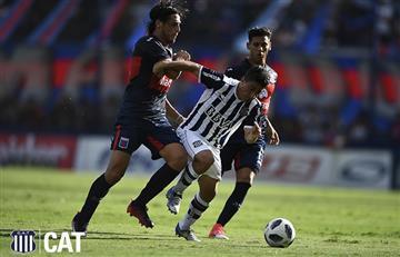 Talleres no aprovechó que Tigre jugaba con uno menos y terminó empatándolo
