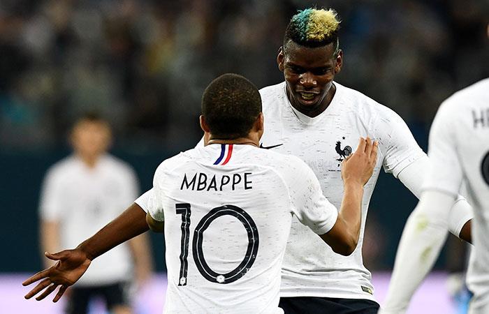 Kylian Mbappé y Paul Pogba. (AFP)