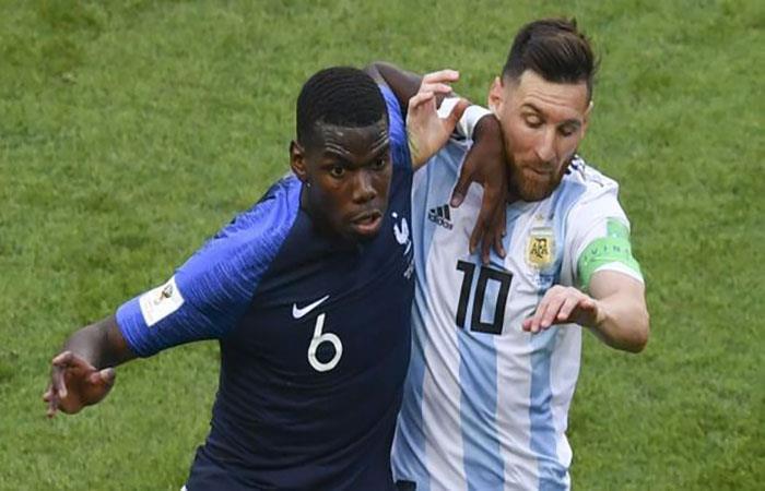 Pogba y Messi disputando el balón en el partido de octavos de final. (Foto: EFE)
