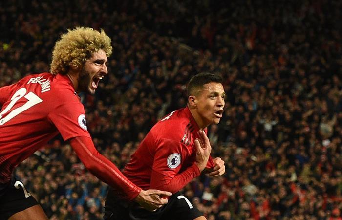Alexis y Fellaini celebran el gol del United. Foto: EFE