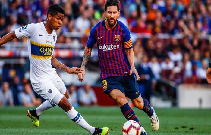 Wilmar Barrios marcando a Lionel Messi. (FOTO: EFE)