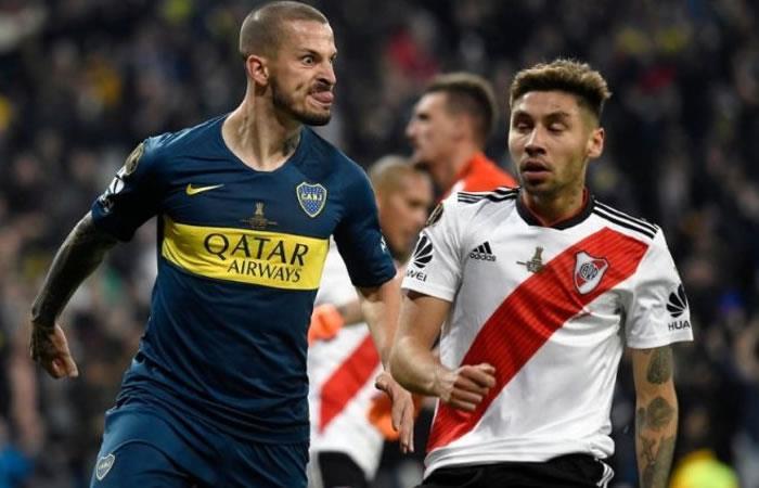 Darío Benedetto y Gonzalo Montiel durante la final de la Libertadores. Foto: AFP.