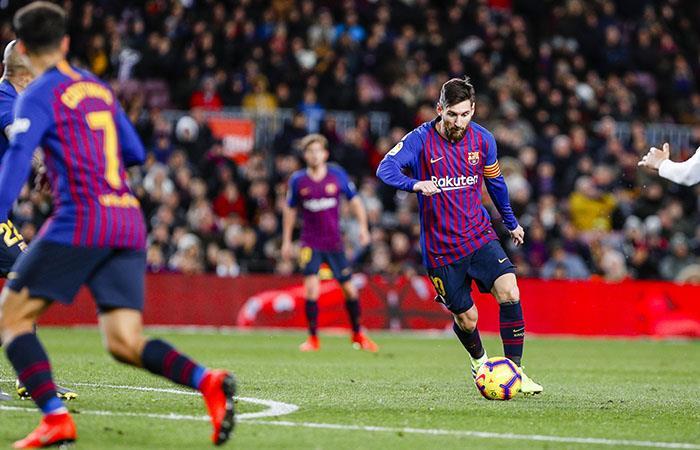 Lionel Messi, en acción ante Valencia. (Foto: AFP)